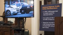 A television displays the distracted driving PSA by Assemblymember Frazier and actor Erik Estrada