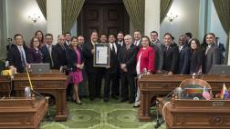 Members of the Assembly pose with Erik Estrada and Assemblymember Jim Frazier.